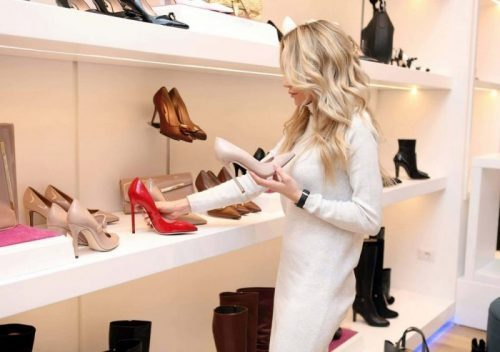 woman-at-shoe-store-318236
